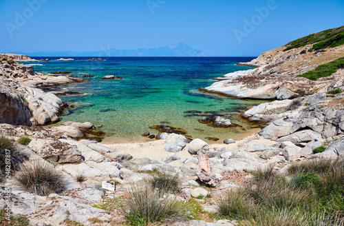 Foto Murales Beautiful beach and rocky coastline landscape in Greece