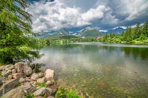 Mountain lake, blue sky and rocks in Strbske Pleso