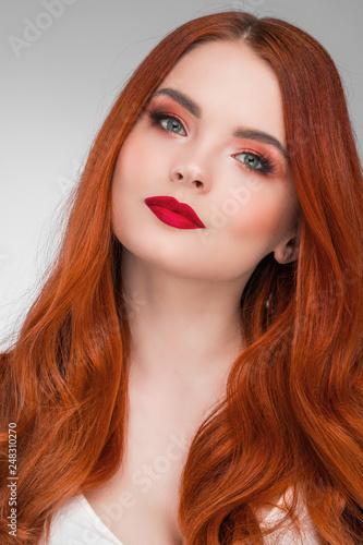 Leinwanddruck Bild Woman with long ginger hair