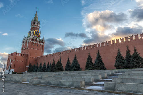 Moscow Kremlin Spasskaya Tower and wall on a beautiful cloudy evening sky background