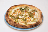 Italian cheese pizza dish with fresh vegetables - 248311298