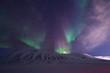 Leinwanddruck Bild - The polar arctic Northern lights aurora borealis sky star in Norway travel Svalbard in Longyearbyen city the moon mountains