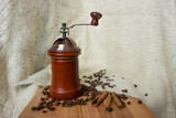 Aromatic coffee beans are ground in a manual coffee grinder. - 248332470