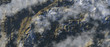 Clouds over snowy mountains. Aerial.