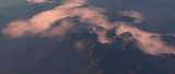 Aerial of mountains covered in clouds. - 248333209