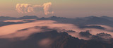 Mountains in fog with cloudy sky at sunrise. - 248333210