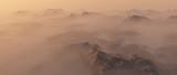 Mountain range in mist at sunrise. - 248333219