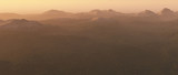 Mountains with snow summits at sunrise. - 248333238
