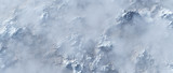 Aerial of rough steep snowy mountains in fog. - 248333243