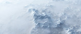 Aerial of rough steep snowy mountains in fog. - 248333244