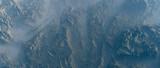 Aerial of rough rocky terrain in fog. - 248333276