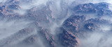 Aerial of rough rock formations in fog. - 248333277