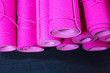 Leinwanddruck Bild - Pink yoga mats on the floor in a gym