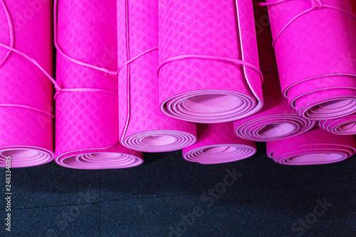 Leinwanddruck Bild Pink yoga mats on the floor in a gym