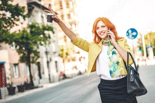 obraz lub plakat Woman Cathcing A Taxi