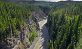 Kuskulana River Canyon in the places where McCarthy Road crosses on it in the Wrangell Mountains. The Wrangell Mountains are a high mountain range of eastern Alaska, UNESCO World Heritage Site