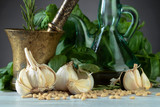 Ingredients for making pesto on a wooden table . - 248359251