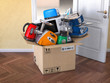 Leinwanddruck Bild - Home  kitchen appliances in open cardboard box. Delivery,  e-commerce and online shopping concept. Microwave oven, blander,  processor, toaster, teapot.