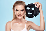 Young beautiful blonde girl. Close up portrait. Taking off black mask. Skin care. Fresh skin. Healthy lifestyle. Fresh skin. Model posing. Facial mask. Perfect smile. Skin treatment. - 248365698