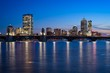 Boston skyline at dusk from cambridge with longfellow bridge and frozen charles river