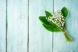 lilly of the valley flowers on wooden surface