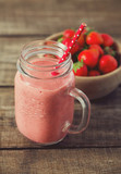 strawberry milk shake on wooden surface - 248393252
