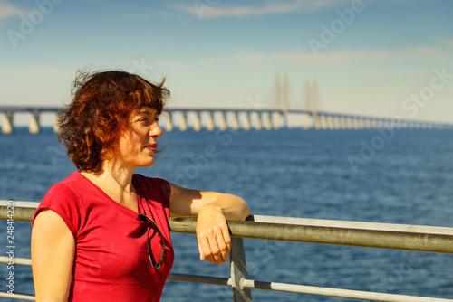 Tourist and Oresund bridge between Denmark and Sweden.