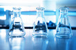 three glass flask of research chemical science laboratory blue education background
