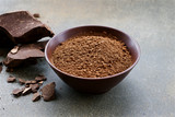 Organic carob powder in a bowl. Natural cocoa substitute. Close up view