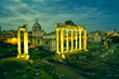 View of the temple of Saturn in Roman forum at night, Italy. Ruins of Septimius Severus Arch and Saturn Temple. Rome architecture and landmark.
