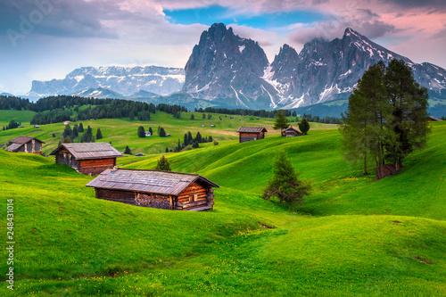 Leinwandbild Motiv Seiser Alm resort and wooden chalets at sunset, Dolomites, Italy