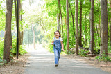 Children, childhood, people concept - little happy child girl walking in summer park - 248431819