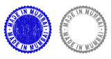 Grunge MADE IN MUMBAI stamp seals isolated on a white background. Rosette seals with grunge texture in blue and grey colors. Vector rubber stamp imprint of MADE IN MUMBAI label inside round rosette.