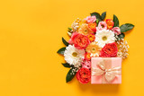 Happy Mother's Day, Women's Day, Valentine's Day or Birthday Pastel Candy Colors Background. Floral flat lay greeting card with beautifuly wrapped present and copy space.