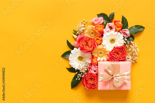 Zobacz obraz Happy Mother's Day, Women's Day, Valentine's Day or Birthday Pastel Candy Colors Background. Floral flat lay greeting card with beautifuly wrapped present and copy space.