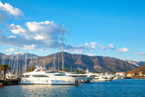 yachts in harbor against the backdrop of the mountains