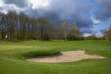 Landscape of a beautiful golf course with greens and holes and bunkers