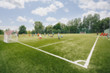 Leinwanddruck Bild - Blurred picture of soccer field at school on summer day time. Background image of blurred football pitch. Image for background usage
