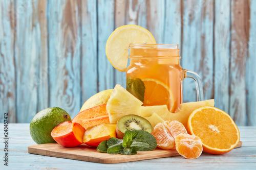 Leinwanddruck Bild Cold fruit lemonade with ice.