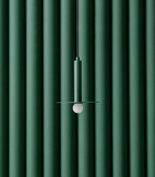 Dark green metal lamp hanging on folded colorful wall background in studio - 248469211