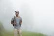 Tourist man backpacker walking alone on nature background