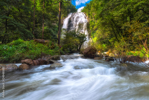 Khlong Lan Waterfall water flowing over rocks coastline.  - 248480881
