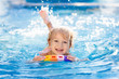 Leinwanddruck Bild - Child learning to swim. Kids in swimming pool.