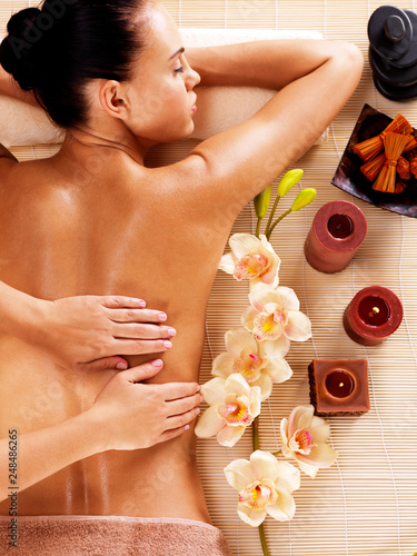 Masseur doing massage on woman back in spa salon © Valua Vitaly