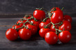Leinwanddruck Bild - red cherry tomatoes on wooden table