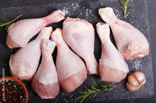 Leinwandbild Motiv fresh chicken meat with ingredients for cooking, top view