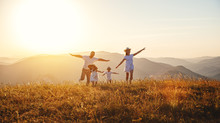 """Постер, картина, фотообои """"Happy family: mother, father, children son and daughter on sunset"""""""