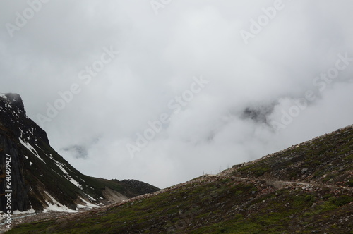 landscape with mountains and clouds - 248499427
