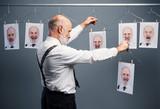 Senior businessman choosing his portraits