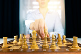 hand of businesswomen moving chess figure in competition success play. strategy, management or leadership concept
